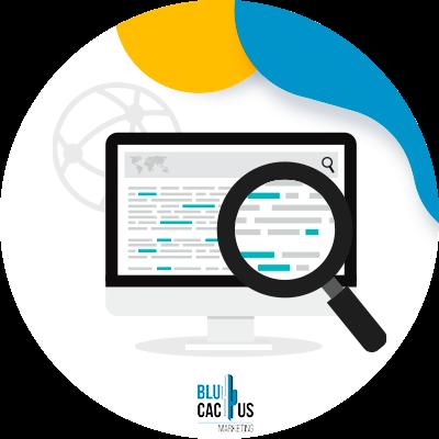 BluCactus - ¿Qué es el Contenido Generado por el Usuario? - lupa con una computadora en ella